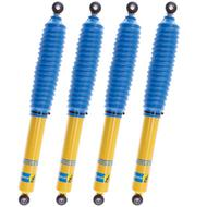 Bilstein 4 4600 Series Yellow Shocks with 4 Blue Shock Boots, Gas Charged - SHOCKINGBIL4600